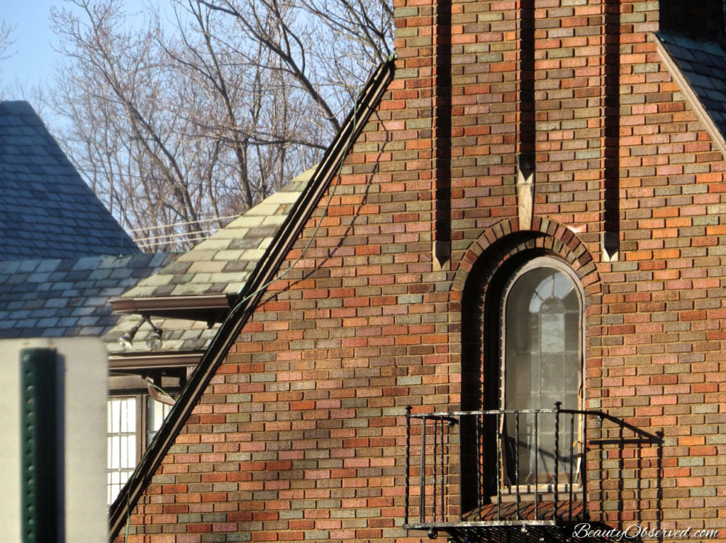 Brick chimney on Tudor House with wrought iron railing from Beauty Observed Interesting architectural detail