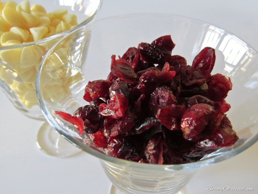 Dried cranberries and white chocolate.  Recipe for Cranberry Bliss-fully Happy Bars at Beauty Observed
