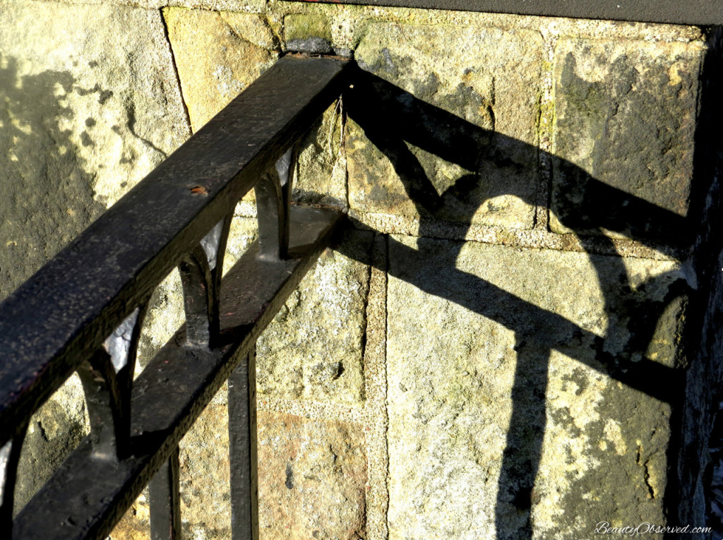 Wrought iron fence railing and stone post from Beauty Observed